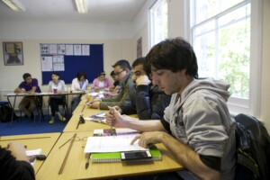 Students in class using various activities for learning English