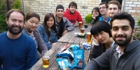 a group of international students having drinks in a beer garden