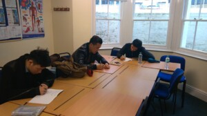 Some of our A1 students writing in their diaries.