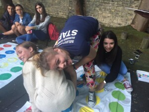 summer school students playing twister